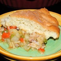 Marie-Eve's Turkey Pot Pie Recipe - Leftover turkey meat, carrots, potatoes, and peas are simmered in a creamy sauce, then baked with a homemade butter pie crust enriched with milk and egg. Most of the cooking is done on the stove, with the final browning done in the oven.