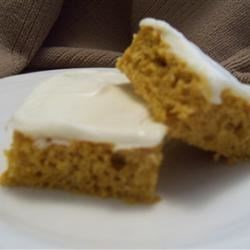 Pumpkin Bars II Recipe - These moist oil-based bars are made with buttermilk baking mix, pumpkin puree and raisins.  Frost with cream cheese frosting.