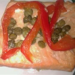 Bell Pepper and Lemon Salmon Recipe - Marinated salmon is cooked with capers in convenient aluminum foil packets that make for easy clean up. This recipe will work great on the grill, too!