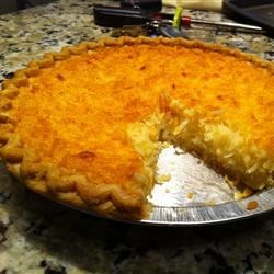 Coconut Pie Recipe - This classic recipe is an easy one. All you need is a bit of flour and sugar, some creamed butter and eggs, milk, and a splash of vanilla. And don 't forget the coconut. It bakes up perfectly in about an hour.