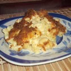 Kicked Up Mac and Cheese Recipe - Macaroni and cheese spiked with hot pepper sauce, dry mustard, jalapeno cheese and chili powder.