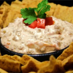 Fabulous Football Dip Recipe - This warm and hearty dip features cooked ground sausage mixed with spicy canned tomatoes and cream cheese for a downright meaty chip accompaniment.
