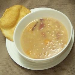 Basic Bean Soup Recipe - White beans and ham are combined with carrots, onion and spices in this simple, yet classic, soup.