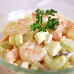 Shrimply Delicious Shrimp Salad Recipe - Shrimp with chopped celery, onions, hard-boiled egg, shredded carrots, and mayonnaise.