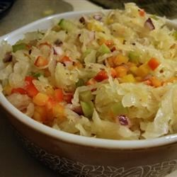 Sassy Sauerkraut Relish Recipe - Sauerkraut, pepped up with crunchy, colorful peppers, celery and onion, makes a scrumptious relish for hot dogs, hamburgers or grilled pork chops.