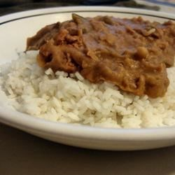 Beans and Rice Recipe - A mixture of refried bean, ground beef, and seasonings over white rice.