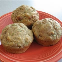 Zucchini Muffins Recipe - Whole wheat muffins, honey-sweetened and packed with flavor, still manage to be low-fat and good for you.  Nonfat milk, egg whites and just a little oil make these the healthy choice.