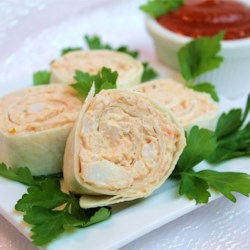 Crabmeat Roll-Ups Recipe - This is an easy and delicious spread, and yet another way to use tortillas for an appetizer. The mixture can also be used without the tortillas as a spread on crackers.