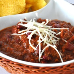 Chili Rick's Recipe - Chocolate and spicy sausage are the signature ingredients in this beef and bean chili.