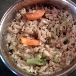 Homemade Dog Food Recipe and Video - Whether you cook for your pooch once in a while or everyday, this recipe will be sure to make some tails wag. This turkey, rice, and vegetable dog food can be fed to the dogs on its own or mixed in with kibble. Lucky Fido!