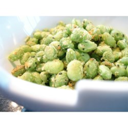Crispy Edamame Recipe and Video - Green soybeans (edamame) are baked under a Parmesan cheese crust, turning a frozen food into a delicious snack!