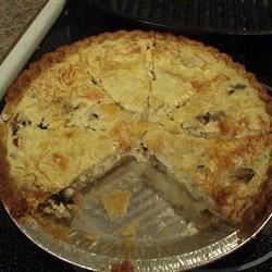 Crabmeat Quiche Recipe - A luscious egg pie with crabmeat, red pepper and Swiss cheese, and a hint of white wine. Serve for a delicious and elegant luncheon!