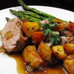 Apple Glazed Pork Tenderloin Recipe - A pork tenderloin is seared, coated with a sweet and tangy blend of apple jelly and balsamic vinegar, and baked with wine-flavored onions and apples for a delicious fall main dish.