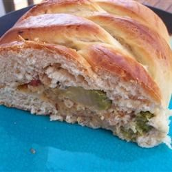 Chicken and Broccoli Braid Recipe - This clever recipe makes innovative use of prepared crescent roll dough. A cheesy chicken and chopped broccoli mixture fills the center.
