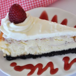 White Chocolate Raspberry Cheesecake Recipe and Video - Raspberry sauce is swirled into the batter of a creamy white chocolate cheesecake. Garnish with white chocolate curls if desired.