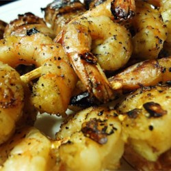 Delia's Grilled Shrimp Sonora Recipe - Butterflied jumbo shrimp dipped in a buttery Parmesan sauce and grilled to perfection.