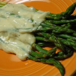 Smoked Asparagus Recipe - Love smoked foods? Love asparagus? This mild but flavorful asparagus and garlic dish made originally in an iron skillet on the top of the smoker is the perfect side to any smoked meat. If you like asparagus, you will love this! So far, everyone has enjoyed it. I hope you do, too.