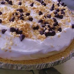 Peanut Butter-Chocolate Banana Cream Pie Recipe - Bananas are drizzled with a chocolate-peanut butter mixture, topped with creamy pudding, spread with more whipped topping and sprinkled with chocolate curls and peanuts.
