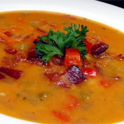 Bean, Bacon and Pepper Soup Recipe - Vegetables are sauteed in bacon drippings and then pureed with canned white beans, chicken broth and seasonings in this soup which is garnished with crisp crumbled bacon and chopped parsley.