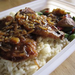 Cola Onion Pork Chops Recipe - Pork chops are baked in a quick cola mixture. This is a great, simple recipe to fix in a hurry.  Perfect served with rice.
