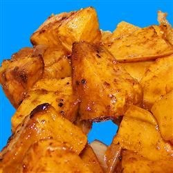 Tropical Sweet Potato Fries Recipe - Sweet potatoes make a perfect summer treat, especially with a nice twist by using lime zest! Boiling the potatoes before hand allows them to cook perfectly once in the oven. This pairs well with seafood and burgers alike.