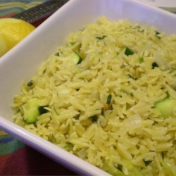Zucchini Orzo Recipe - Orzo, the ricelike pasta, is lightly flavored with lemon, then stirred into cooked sweet onion, zucchini, and yellow squash for a colorful side dish that's quick and light.