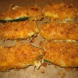 Jalapeno Poppers I Recipe - Sharp Cheddar cheese is the rich, delicious filling for these spicy favorites! They are baked rather than deep fried. You'll want to pop them down one after another!