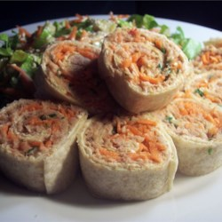 Chili Tuna Roll-Ups Recipe - An easy light snack or supper dish. A mixture of tuna, sweet chili sauce and spring onions wrapped up in a layer of light cream cheese on tortilla (wraps).