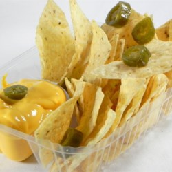 Nacho Cheese Sauce Recipe and Video - Here's a simple cheese sauce to spread over tortilla chips. Add some jalapenos to spice things up a bit.