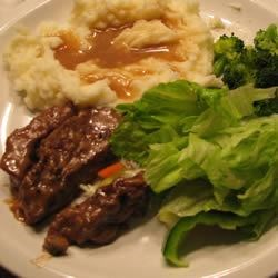 Round Steak and Gravy II Recipe - Succulent round steak seared, then braised in cream of mushroom and French onion soups until tender. Great with mashed potatoes, as it makes it's own gravy.