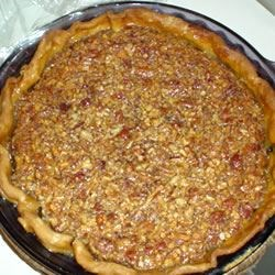 Brandy Pecan Pie Recipe - This is the one pie that I always required my mom to make for the holidays.  I would always want to cut into it right when it came out of the oven, but I would have to wait until after dinner!  It is worth the wait!