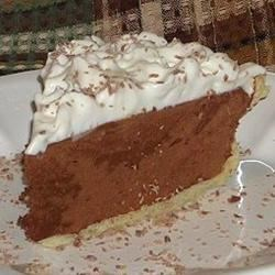 Sinfully Delicious Chocolate Pie Recipe -  There are lots of sugar, eggs, chocolate and butter in this decadent pie. Everything is put into a bowl and beaten, until the mixture is light, fluffy and thoroughly combined. The filling is then poured into a baked, deep-dish pastry shell and chilled. Nice to serve with whipped cream and a sprinkling of cocoa.