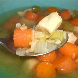 Chicken, Rice and Vegetable Soup Recipe - Bite-sized pieces of chicken breast are simmered in chicken stock with carrots, celery, and white rice.