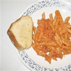 Penne a la Vodka I Recipe - A savory saute of sweet red onions, garlic and bacon is deglazed with vodka and simmered with tomatoes  and cream to make an opulent sauce to serve over cooked penne.
