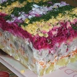 Russian Beet Salad with Herring Recipe - Onion, herring, potatoes, carrots, and beets are layered in this Russian salad.