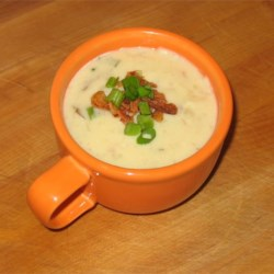 Cream of Potato Soup I Recipe - Celery and carrot flavor the stock of this pureed potato soup made with a can of evaporated milk.  Serve garnished with chopped chives.