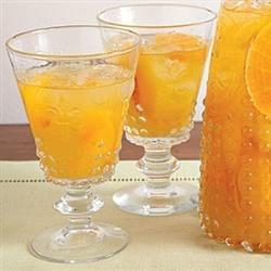Orange Sangria Recipe - This sangria is light and crisp, as it is made with a dry white wine instead of red.  It is the perfect cocktail for a warm summer's evening.