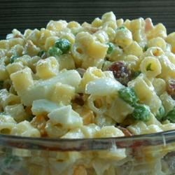 THE Pasta Salad Recipe - This is a wonderful cold pasta salad with ham, hard cooked eggs, Swiss cheese, and peas.  Tossed with a creamy, spicy dressing, this salad is also great with macaroni, rotini, or your favorite shaped pasta.