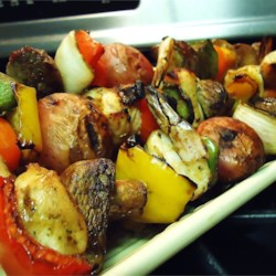 Tangy Almond Chicken Kabobs Recipe - Chunks of chicken are grilled with a sweet, tangy marinade, and coated with toasted almonds.