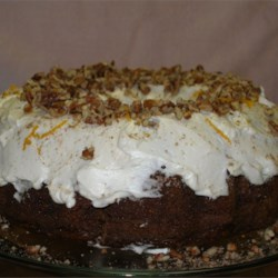 Pat's Award Winning Carrot Cake Recipe - A moist carrot cake made with both baby food carrots and grated carrots, plus chopped pecans and coconut, baked in a Bundt pan. Decorate with cream cheese frosting and chopped pecans, if desired.