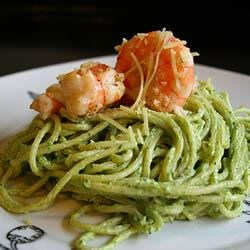 Creamy Pesto Shrimp Recipe - Butter, cream, Parmesan cheese and pesto converge into a luxurious sauce to be served with cooked shrimp or crab meat and hot linguine.
