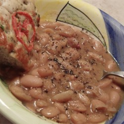 Slow Cooker Ham and Beans Recipe - This recipe is perfect for those blustery days when you don't really have time to cook, but want a hearty meal for the family. It's a very basic, nutrient-packed meal for all to enjoy!