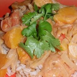Guinean Peanut Sauce with Butternut Squash Recipe - Butternut squash is simmered in a peanut sauce flavored with garlic, onion, and lemon juice, served over medium-grained rice. Okra sauce is a traditional West African accompaniment.
