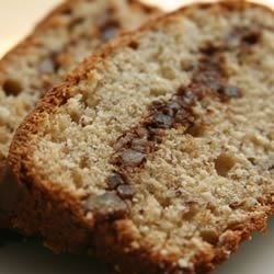 Creamy Banana Bread Recipe - A ribbon of pecan streusel runs through this rich cream cheese-banana bread.