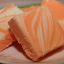 Orange Cream Fudge Recipe - This simple recipe combines cream, butter, marshmallow creme, white chocolate and orange extract to make this classic favorite.