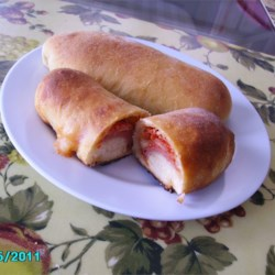 Pepperoni Rolls Recipe - Sweet soft rolls have a surprise filling of pepperoni in this favorite regional treat.