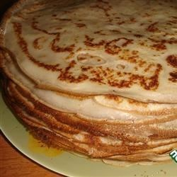 Blini (Russian Pancakes) Recipe - These filled pancakes are served during Russia's Pancake Week (Maslenitsa) celebration before Lent begins. Traditionally they're filled with caviar, jam, sour cream, or mushroom filling.