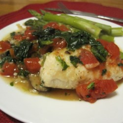 Cousin Cosmo's Greek Chicken Recipe - Excellent for a quick weeknight dinner or an taste-pleasing entree for guests, these braised chicken breasts stuffed with a mixture of feta, lemon juice, and oregano, and cooked with fresh spinach and ripe tomatoes, are gratifyingly delicious.