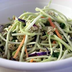 Broccoli and Ramen Noodle Salad Recipe and Video - Those tidy packages of Ramen noodles seem to be quite versatile. Here they turn a broccoli salad into something special. The seasoning packet and a bit of oil and vinegar make the dressing, and the crunchy noodles combined with sunflower seeds, peanuts and green onions, do wonders for the broccoli slaw.