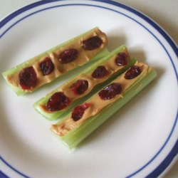 Red Ants on a Log Recipe - This cranberry-studded play on a traditional snack is great for any occasion. You can have it for a great pick-me-up, or to cure your sweet tooth.
